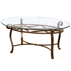 Pictured is the Camino Oval Cocktail Table which measures 32-in by 49-in by 19.75-in with custom iron finishes and table top options to choose from.