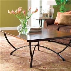 Pictured is the Hudson Rectangular Cocktail Table which measures 54-in by 42-in by 20.75-in with custom iron finishes and table top options to choose from.