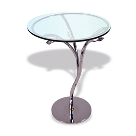 "Pictured here is the Silver Leaf Chrome Accent Table with 18"" Glass Top hand crafted by skilled artisan blacksmiths."