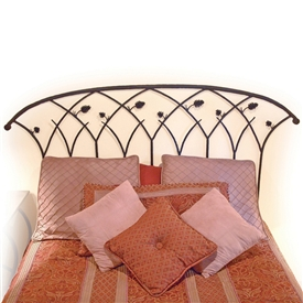 Pictured here is the Piney Woods Wrought Iron Headboard hand forged by artisan blacksmiths.