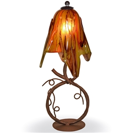 Pictured is our Rustic style wrought iron San Saba Table Lamp with Small Glass Shade hand-made by Mathews & Co.