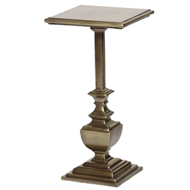 Pictured is the Linton Accent Table which features an aluminum table top and an aluminum frame with a Antique Brass finish by Prima that measures 12-in x 12-in x 24.25-in
