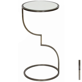 Pictured is the Anstey Accent Table which features a Mirrored Glass table top and a Metal frame with your choice of Antique Brass or Pewter finish options by Prima that measures 12-in x 12-in x 23.5-in