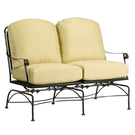 Pictured is the Fullerton Dual Spring Rocking Loveseat from Woodard Outdoor Furniture, sold by Timeless Wrought Iron.