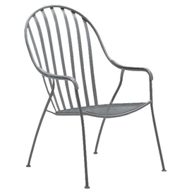 Pictured is the Stackable Valencia High Back Barrel Chair from Woodard Outdoor Furniture, sold by Timeless Wrought Iron.