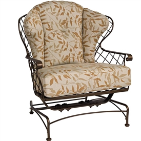 Pictured is the Brayden Spring Base Lounge Chair from Woodard Outdoor Furniture, sold by Timeless Wrought Iron.