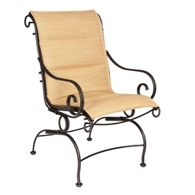 Pictured is the Terrace Padded Sling Coil Spring Dining Chair from Woodard Outdoor Furniture, sold by Timeless Wrought Iron.