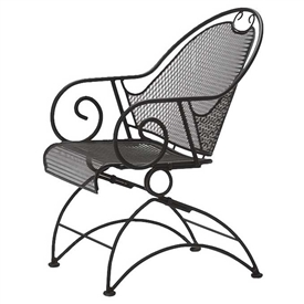 Pictured is the Cantebury Coil Spring Barrel Chair from Woodard Outdoor Furniture, sold by Timeless Wrought Iron.