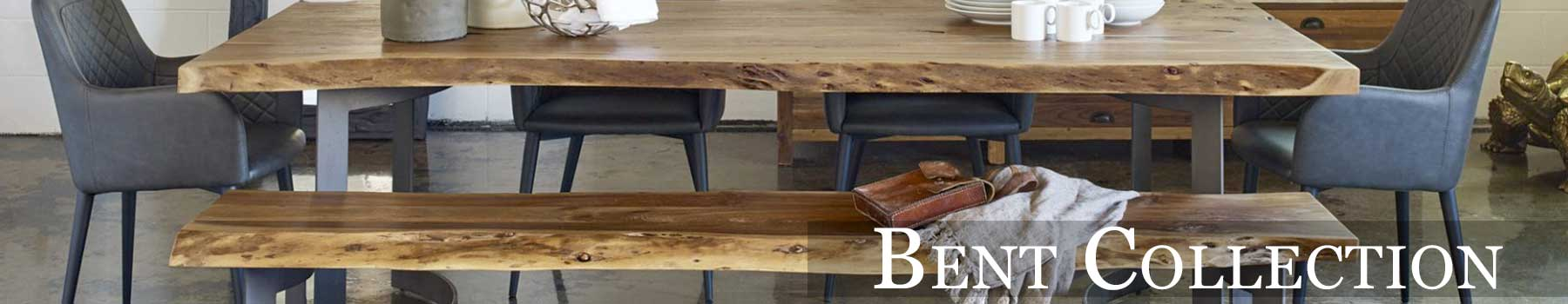 Pictured is our Bent Dining Table and Bench representing the Bent Furniture Collection
